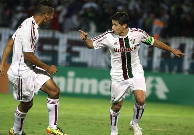 Conca comemora com Samuel o gol da vitória tricolor