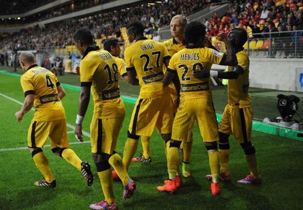 Divock Origi celebrates scoring against Caen on Friday night.