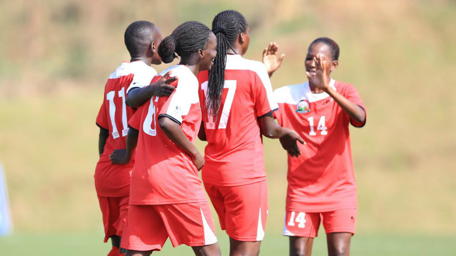 Harambee Starlets players celebrate