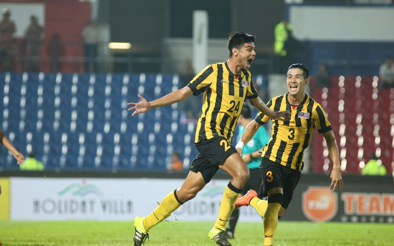 Malaysia's Khair Jones (left) celebrating his goal with Brendan Gan 2016