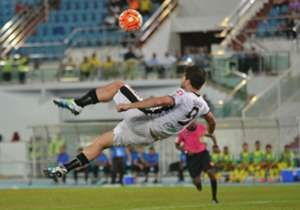 Perak's Xhevahir Sukaj attempting an overhead kick against Pahang