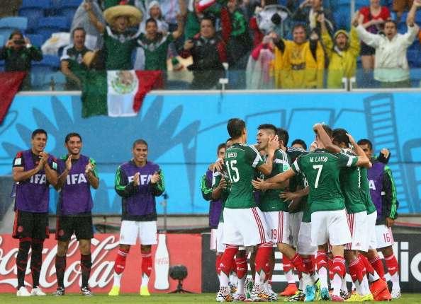 Meksiko mendapatkan kemenangan perdana di Piala Dunia 2014.