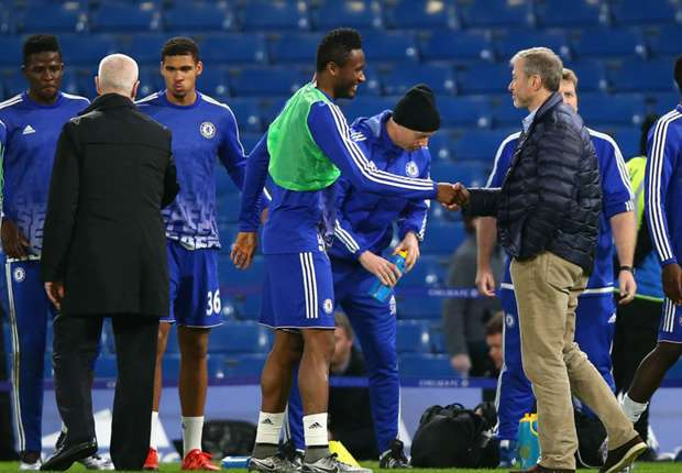 Mikel shakes hands with Chelsea owner Roman Abramovich