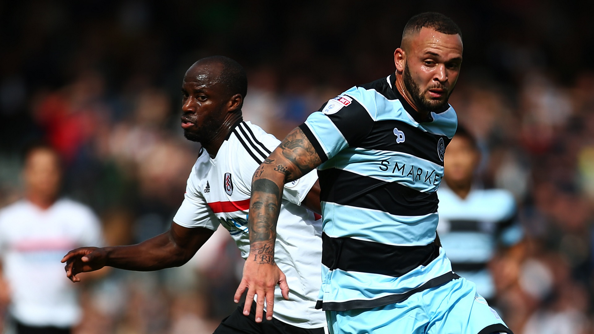Sone Aluko of Fulham and Joel Lynch of Queens Park Rangers