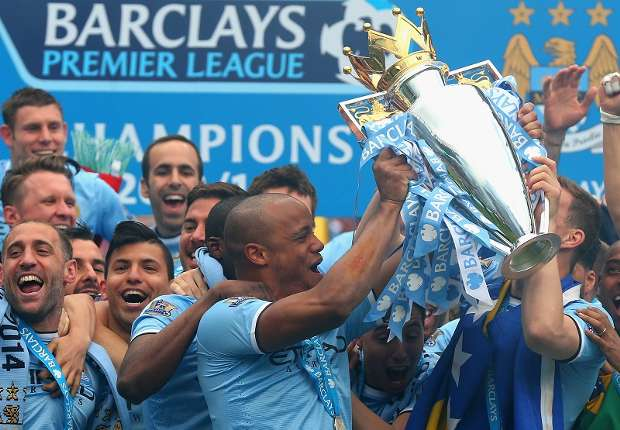 Man City captain Vincent Kompany lifts the Premier League trophy