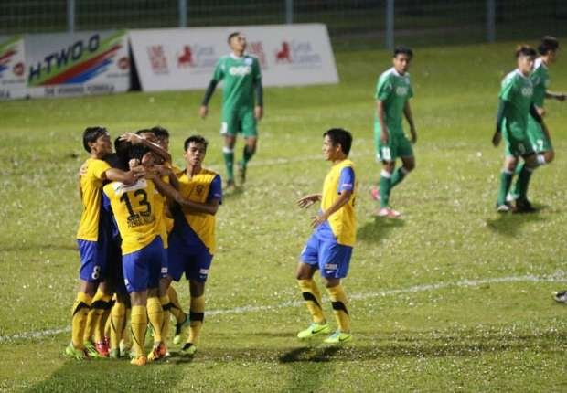 Harimau Muda celebrate the goal that gave them their first points of the 2014 season.