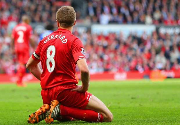 Gerrard on his knees during defeat to Chelsea. He made a costly error for the first goal.