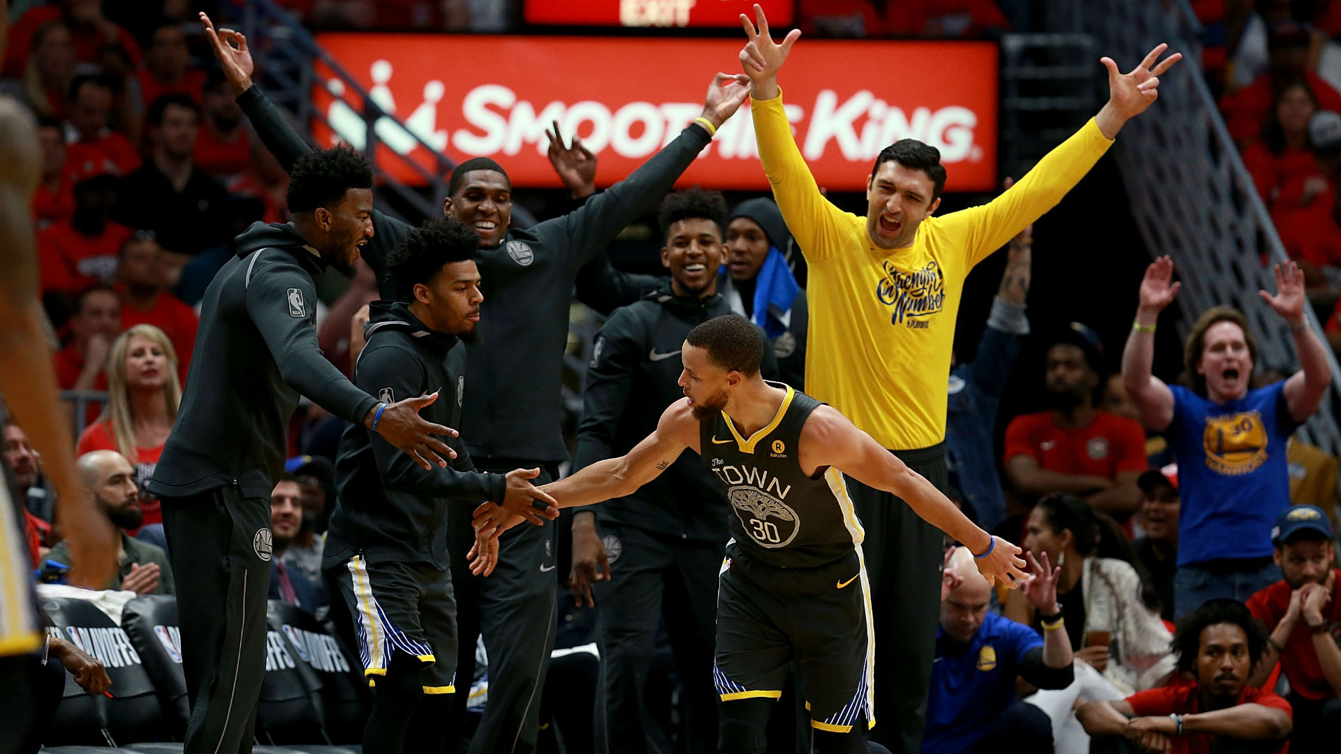 Warriors guard Stephen Curry celebrates with Golden State bench