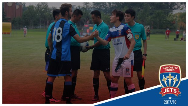 Jets captain Patrick Langlois shakes hands with his Club Brugge equivalent pre-match