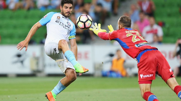 Jets goalkeeper Jack Duncan contests for possession with City star Bruno Fornaroli