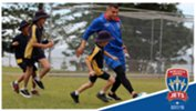 Andrew Nabbout playing football with kids at Port Macquarie Public School on Tuesday
