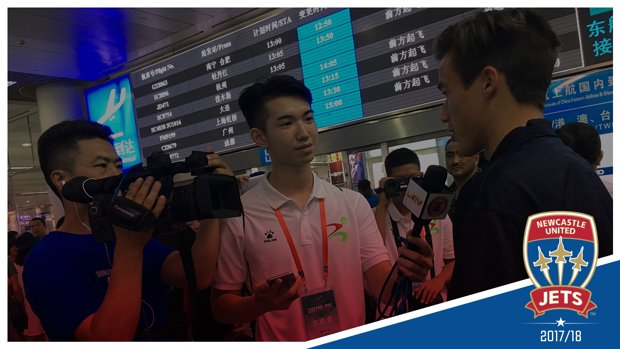 Patrick Langlois speaks with local media after arriving at Qingdao International Airport