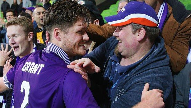 Alex Grant celebrates with fan