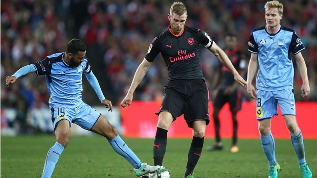Brosque Tackles Mertesacker