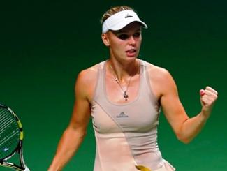 Wozniacki Digs Deep To Shock Sharapova