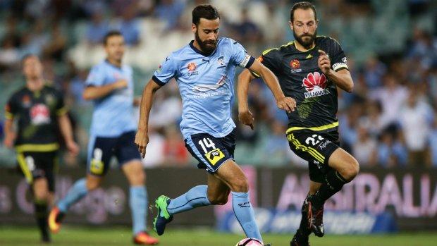 Nix skipper Andrew Durante challenges Sydney FC's captain Alex Brosque.