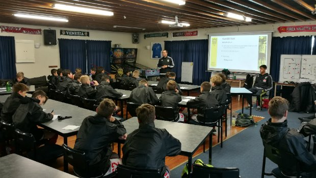 Academy head coach Andy Hedge takes the boys theory a theory session with graduate and first-team player Logan Rogerson.