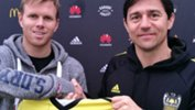 Darije Kalezic presents Daniel Mullen with his Wellington Phoenix shirt.