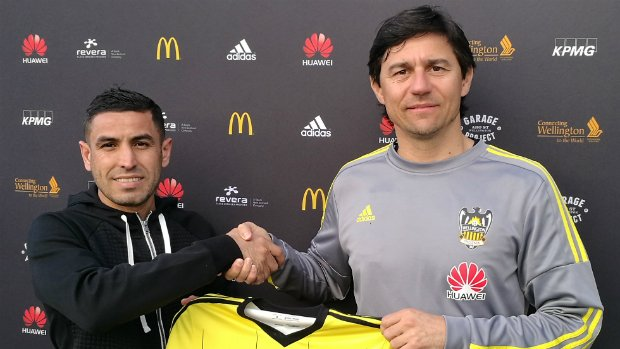 Head coach Darije Kalezic present Ali Abbas with his Wellington Phoenix shirt.