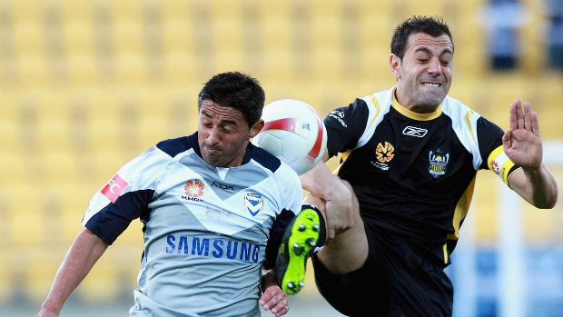Wellington Phoenix captain Ross Aloisi and Carlos Hernandez battle for the ball in Phoenix's first-ever A-League game.