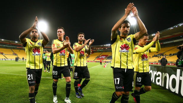 Vince celebrates with teammates following the 3-0 win over Melbourne Victory
