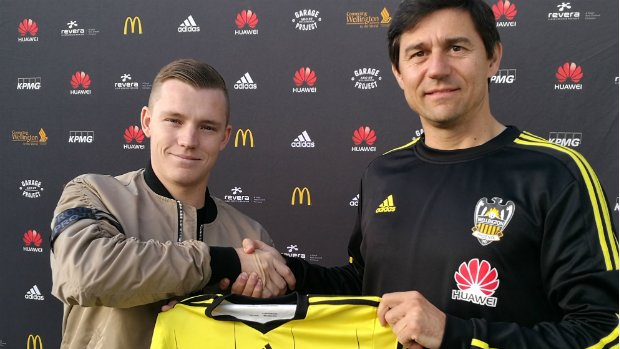 Head coach Darije Kalezic presents Scott Galloway with his Wellington Phoenix jersey.