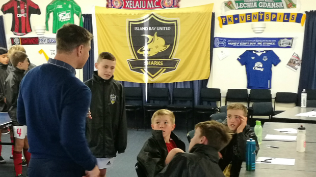 Wellington Phoenix Club Ambassador and legend Ben Sigmund chats to some of the boys during lunch.