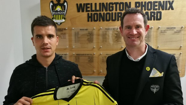 General Manager David Dome presents Andrija Kaluderovic with his Phoenix shirt.