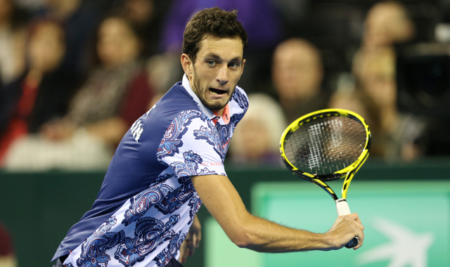 James Ward (GBR) hits a deft shot en route to victory over John Isner in the World Group first round