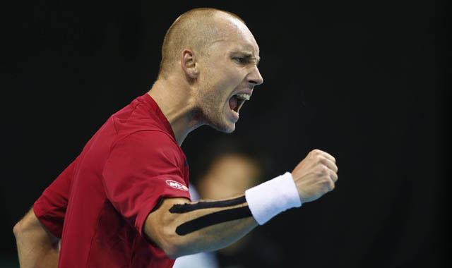 Belgium's Steve Darcis hits a wonderful backhand winner down the line