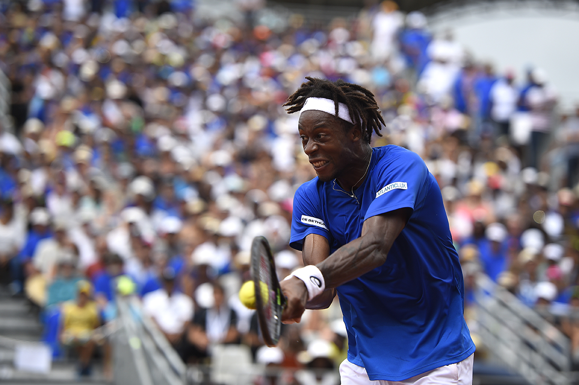 Gael Monfils wins a fun exchange at the net to claim shot of the day