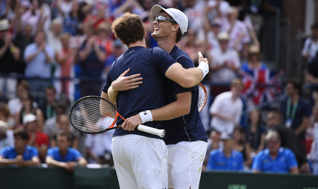 Andy Murray (GBR) finishes off a brilliant exchange at the net in the Great Britain v France tie