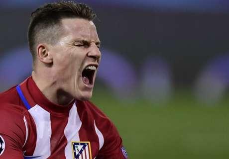 Atletico Madrid guarantee top spot