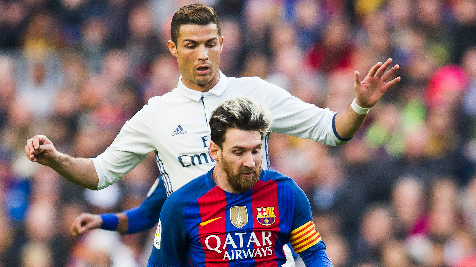 Messi and Ronaldo share adorable kiss ahead of Clasico in Barcelona street art