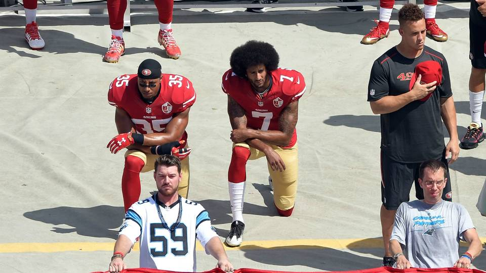 Eric Reid   Colin Kaepernick San Francisco 49ers kneel during the national  anthem before their game caf8c549c