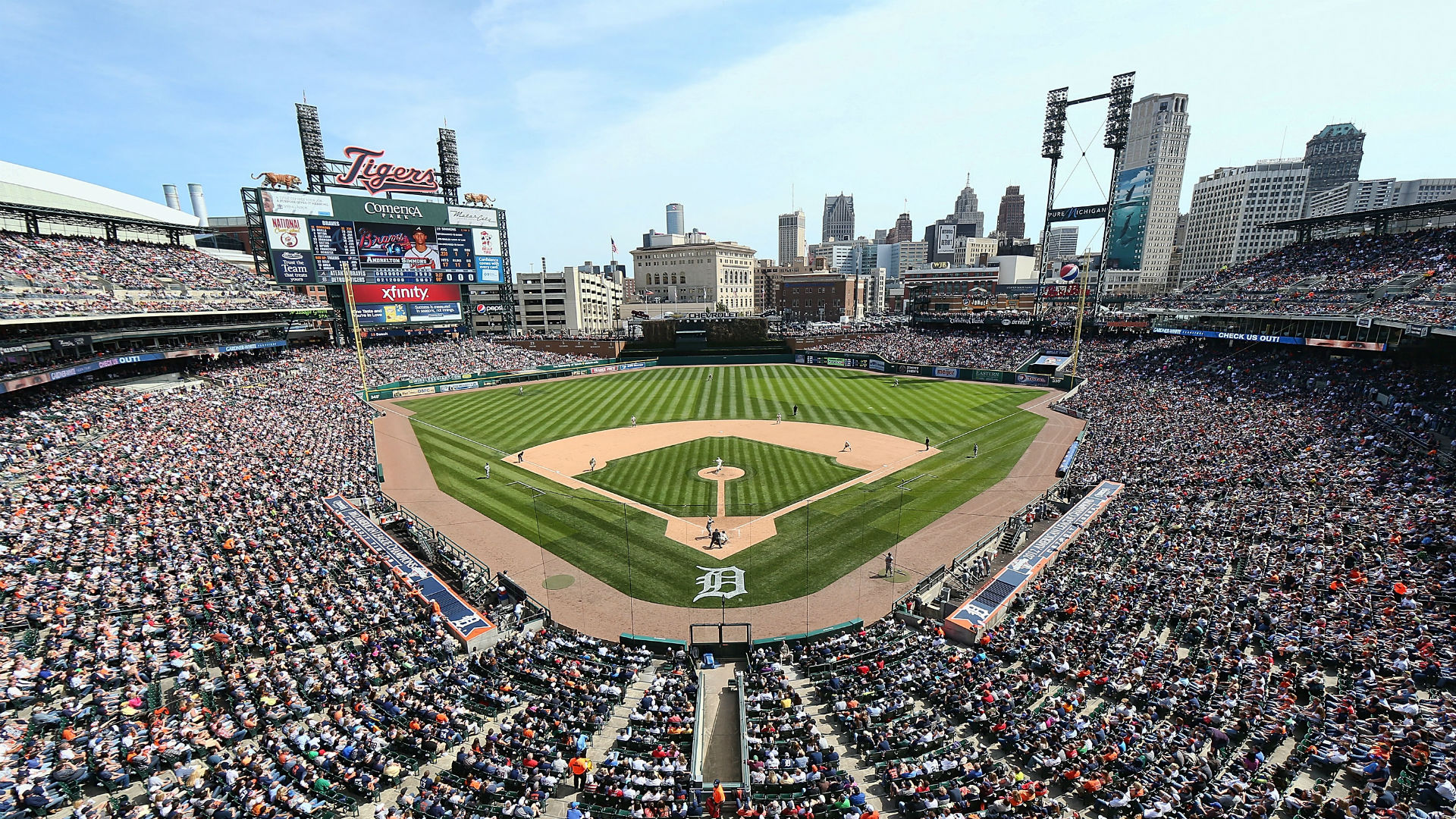 Comerica Park worker charged with felony after spitting on