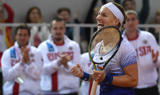 Svetlana Kuznetsova hits a brilliant reaction forehand that drops inside the line en route to victory over Julia Goerges
