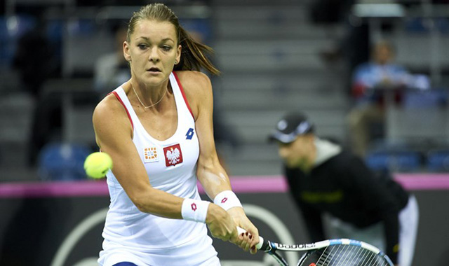 Poland's Agnieszka Radwanska hits a wonderful backhand winner