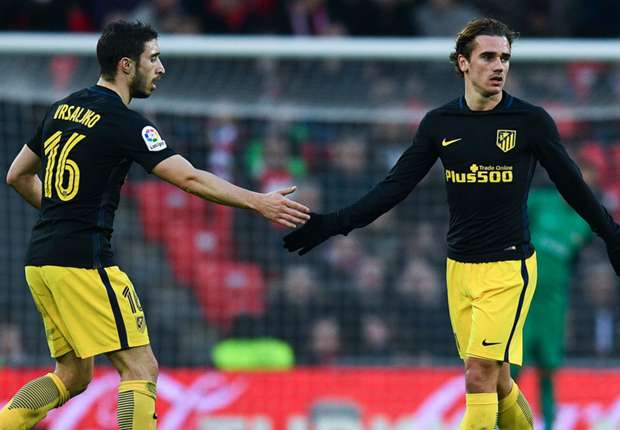 Atletico Madrid's Antoine Griezmann is congratulated on his goal