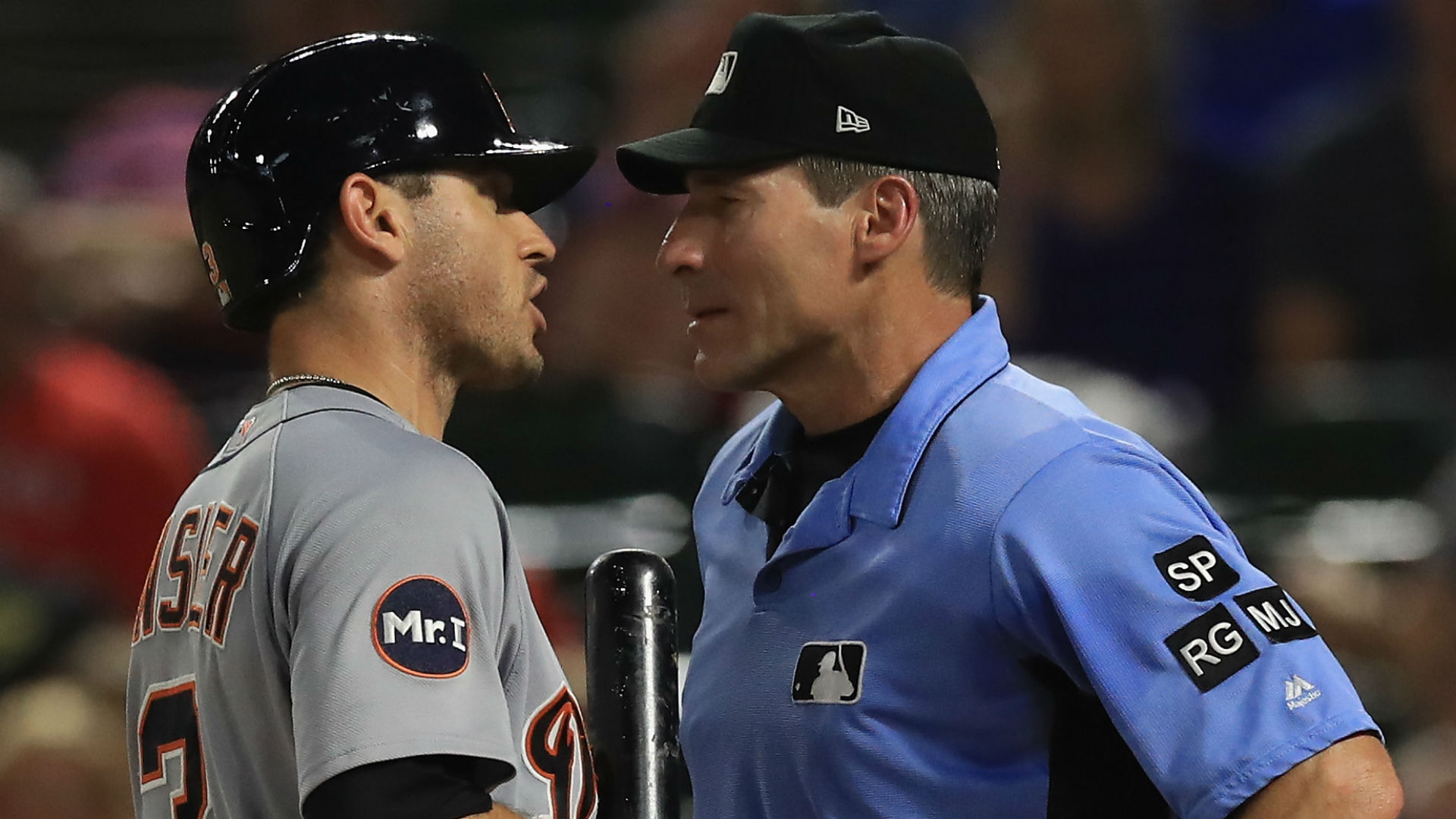 Umpires across Major League Baseball wear white wristbands in protest