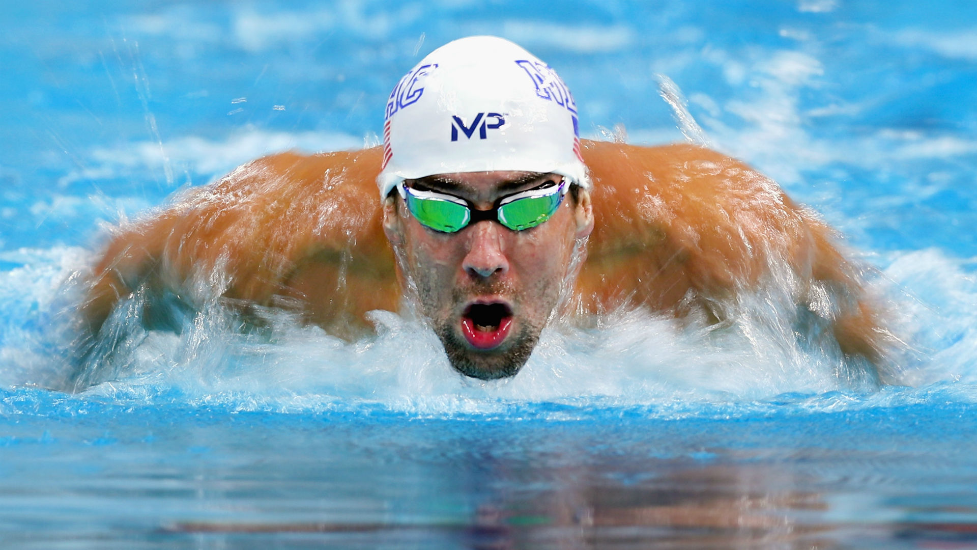 Michael phelps cruises in opening race at u s olympic for Swimming images