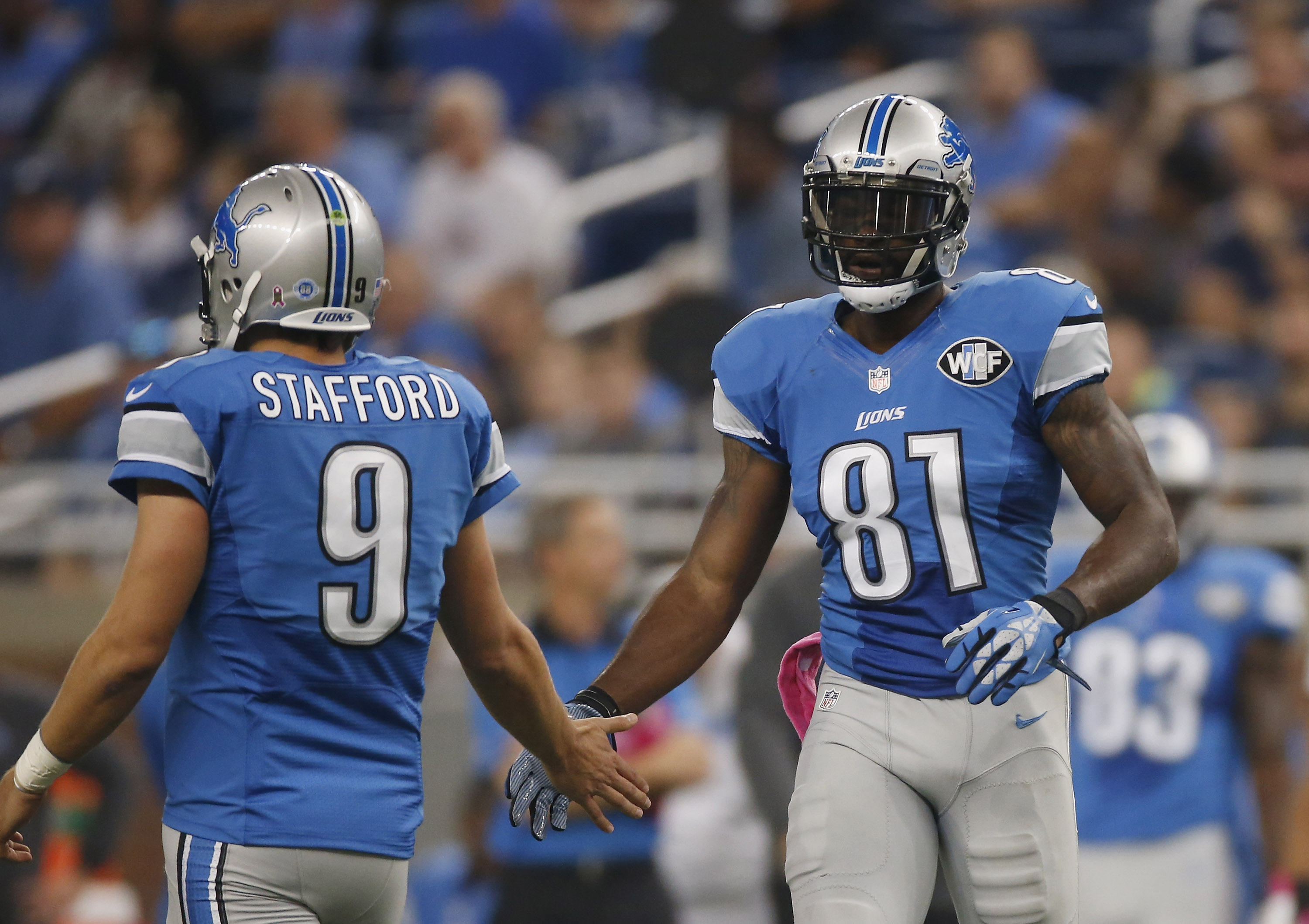 Matthew-stafford-and-calvin-johnson_ppg54lopl9719waxh58cja30