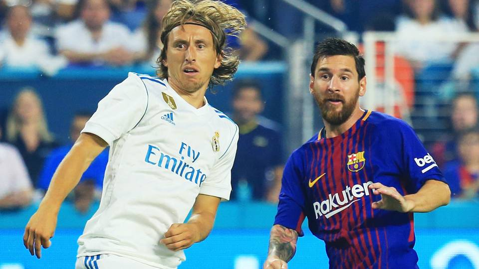 Luka Modric and Lionel Messi - cropped