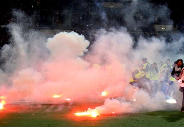 Flares are thrown on to the pitch at the Coppa Italia