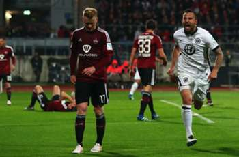 Chandler limps off as Eintracht Frankfurt beats Nurnberg to secure Bundesliga status