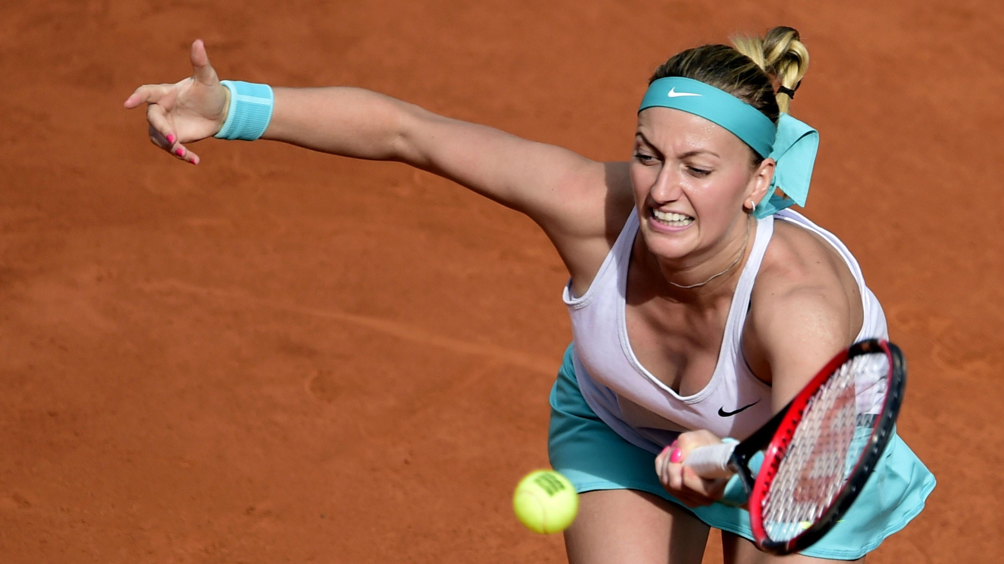 Petra Kvitova storms past Svetlana Kuznetsova to Madrid title