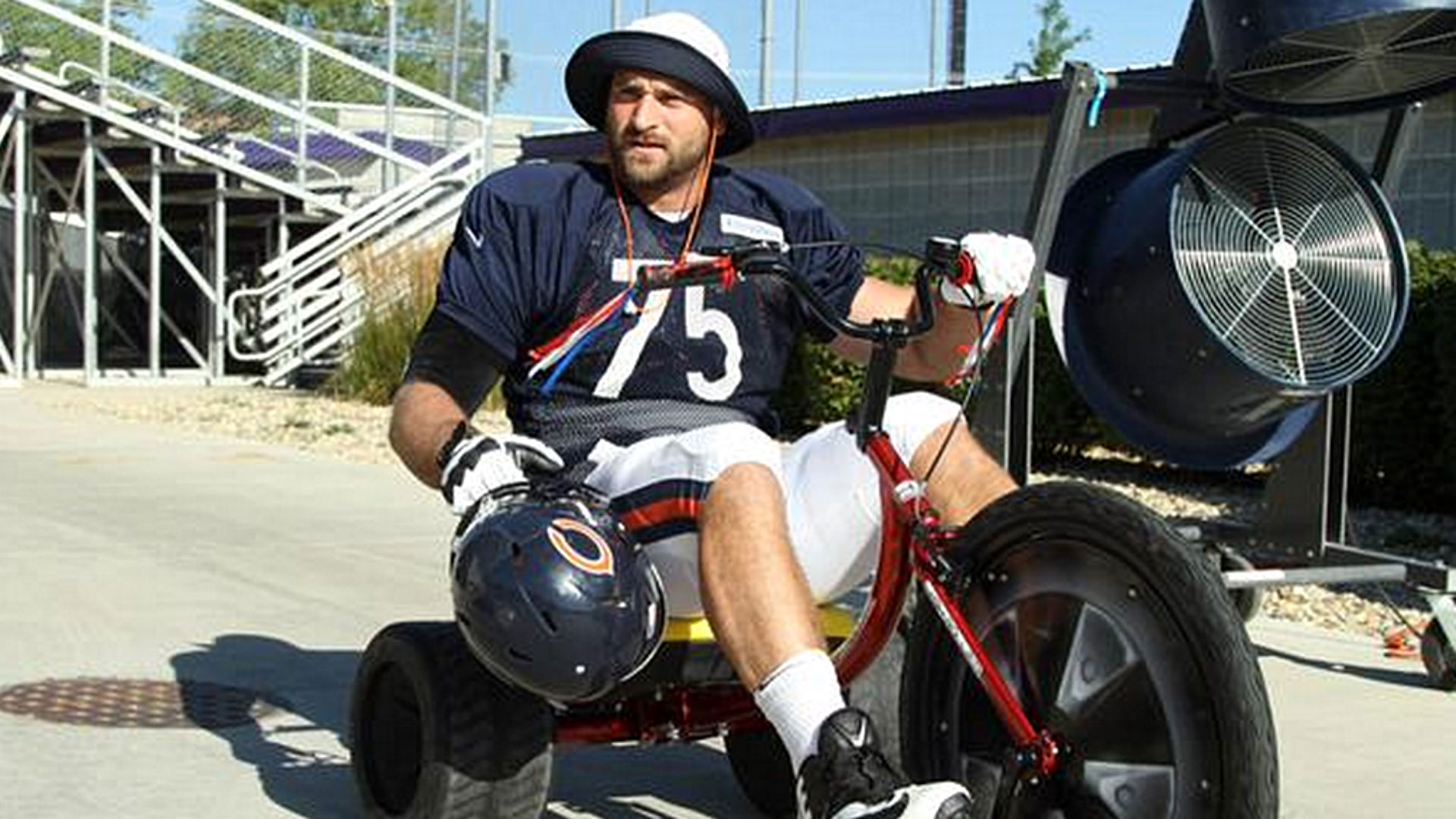 Kyle Long rolls up to practice on Big Wheel, sasses haters