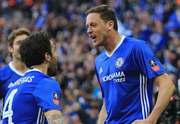 Nemanja Matic (right) celebrates with Chelsea team-mate Cesc Fabregas