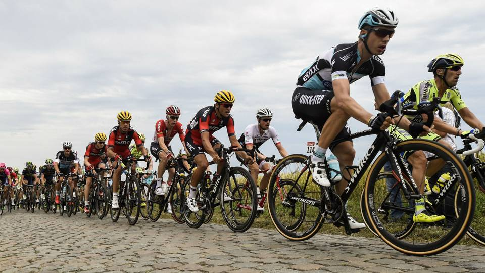 Tony Martin, second from right, tackles the cobblestones