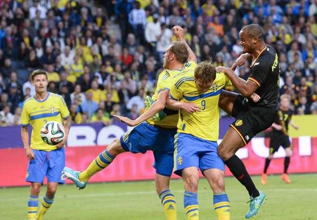 Belgium captain Vincent Kompany heads the ball